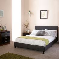 See more information about the Bed In A Box Black Faux Leather Double 4ft 6in Bedstead